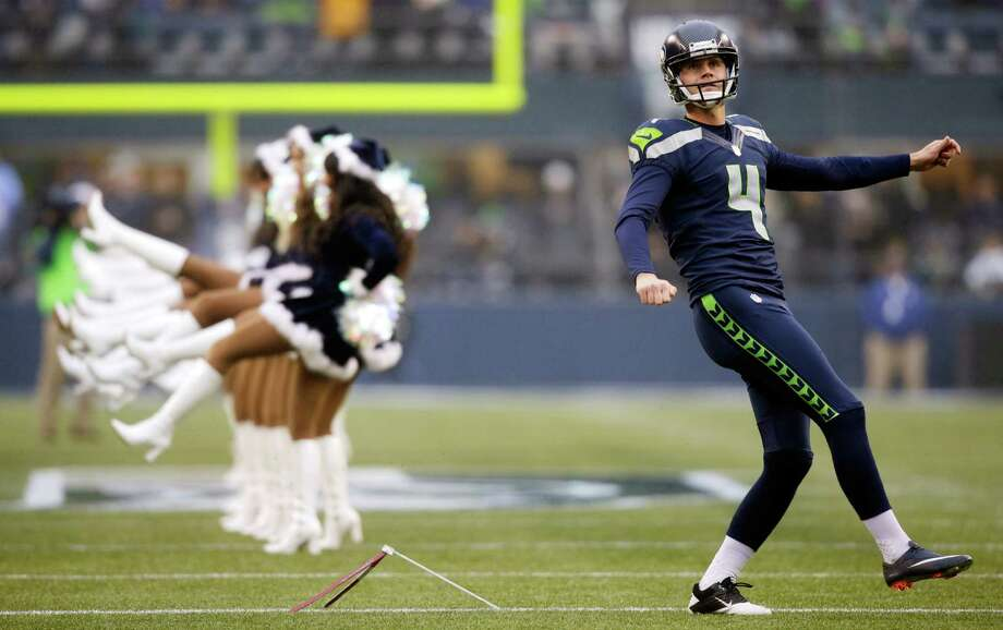 Seattle Seahawks kicker Steven Hauschka warms up near Seattle Seahawks Sea Gals cheerleaders Dec. 22, 2013. (AP Photo/Stephen Brashear) Photo: Stephen Brashear, Ap/getty / FR159797 AP