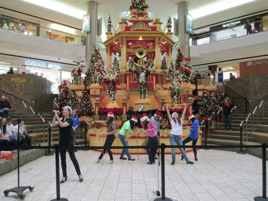 New Canaan High School Theatre students entertain shoppers at the Stamford Town Center mall on Dec. 7 Photo: Contributed Photo, Contributed / New Canaan News Contributed