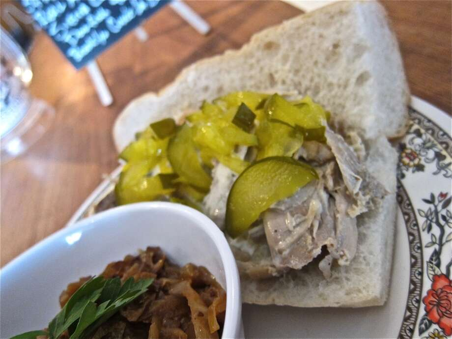 White BBQ Pulled Chicken Po'boy with house pickles at D&T Drive Inn. Photo: Alison Cook