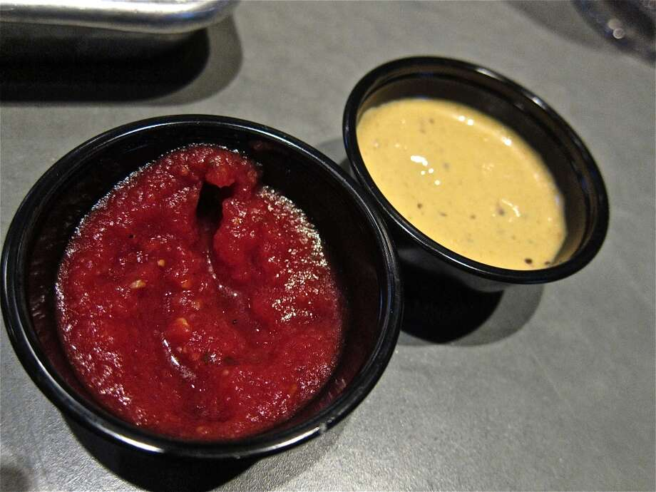 Getting saucy at Fielding's Wood Grill in The Woodlands. Photo: Alison Cook