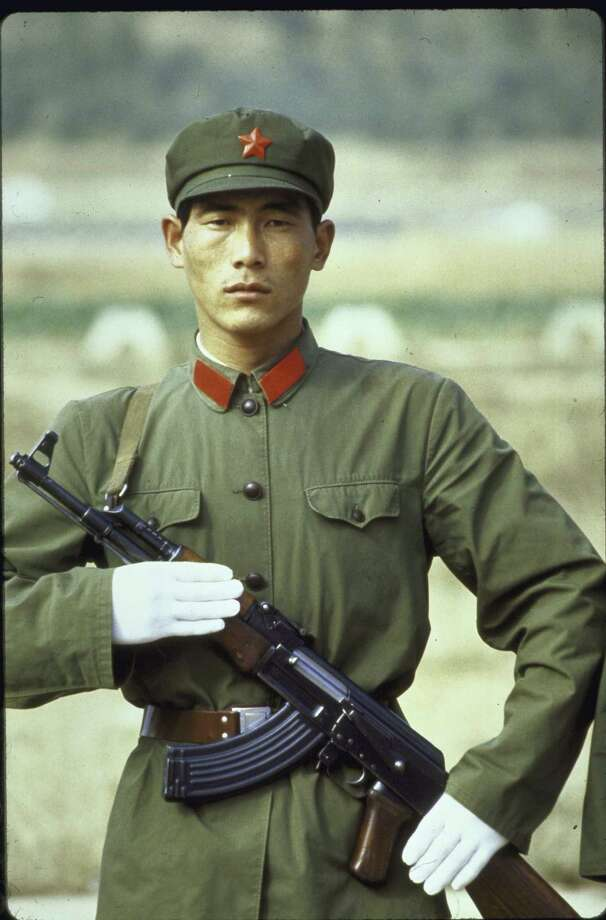 1984: A Chinese soldier carrying an AK-47 rifle. Photo: Kaku Kurita, Getty Images / Time Life Pictures