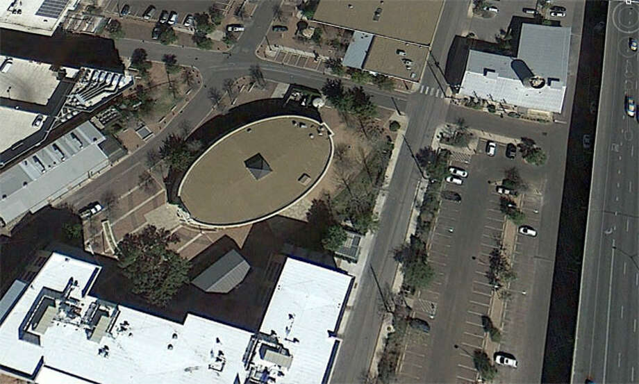 Can you identify this oval-shaped building from this far?