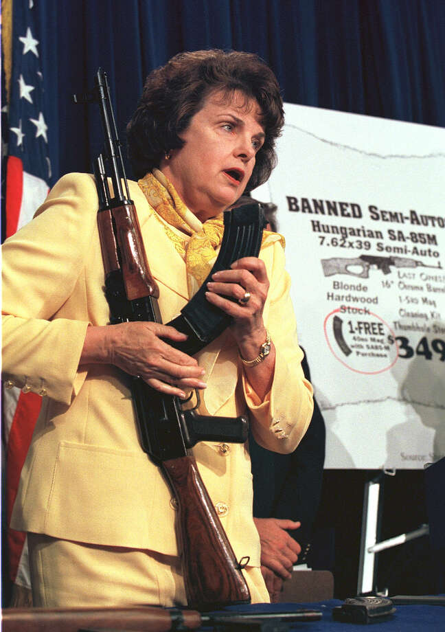 1998: Sen. Dianne Feinstein (D-Calif.) holds an AK-47 semi-automatic rifle with an expanded clip during a press conference calling for the end of a loophole in the law which allows imports of such products. Photo: Richard Ellis, Getty Images / Hulton Archive