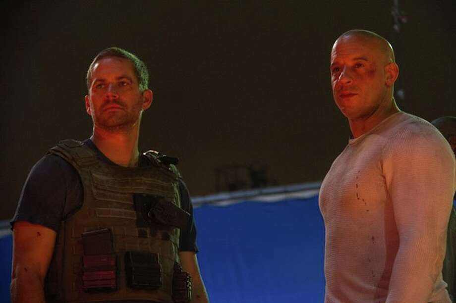 Vin Diesel shared this 'Fast and Furious 7' production photo on his Facebook page, along with the announcement that the new film installment is slated for release on April 10, 2015 despite Paul Walker's death.Click through to see Paul Walker through the years. Photo: Facebook