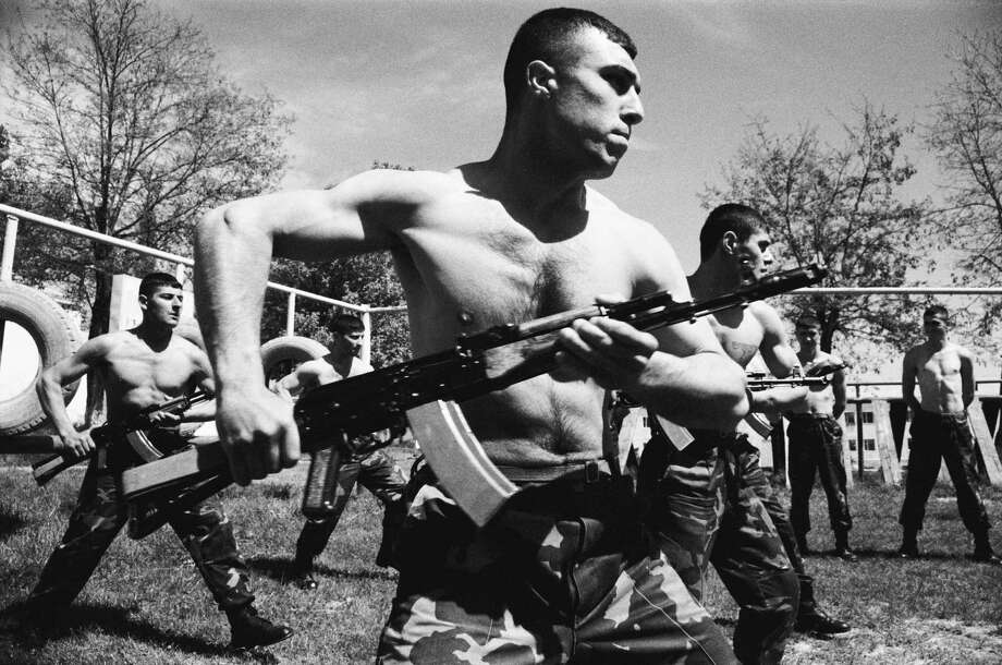 2004: Soldiers from the NKR Defense Army train in close combat with AK-74s inside the barracks in Stepanakert, Nagorno-Karabakh, a disputed region that is internationally recognized as part of Azerbaijan. Photo: 1996-98 AccuSoft Inc., All Rights Reserved, Getty Images / Jonathan Alpeyrie
