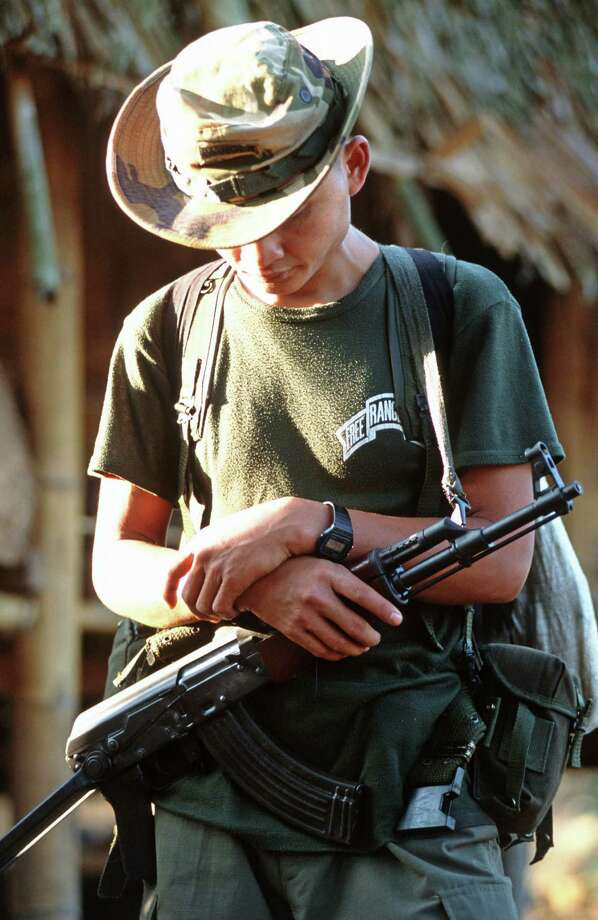 2005: A guerrilla in charge of the security of the Free Burma Rangers team prays before departing on a mission.  With the help of foreign volunteers, teams of Karen nurses, guerillas and porters travel deep inside Burmese territory with a mission to find and help the hundreds of thousands of ethnic refugees hiding in the jungles from Burmese military terror.  Calling themselves the Free Burma Rangers (FBR), they smuggle thousands of dollars of medical aid past the Burmese army lines to their own people.. Photo: Thierry Falise, Getty Images / © 2005 Thierry Falise