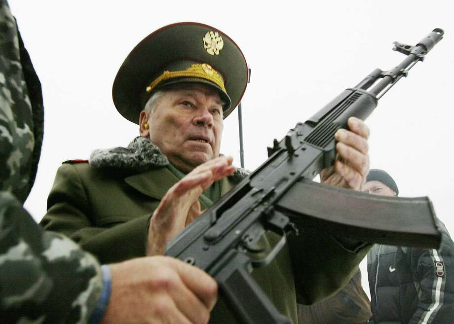 2002: Mikhail Kalashnikov, the father of the world's most popular assault rifle, is handed  an AK-74 November 23, 2002 in Izhevsk, Russia. Photo: Oleg Nikishin, Getty Images / 2002 Getty Images
