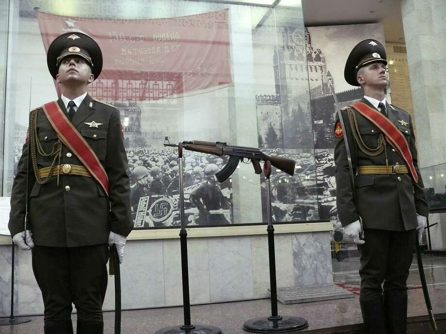 2007: Soldiers standing guard over the original AK-47 rifle, at the ceremony celebrating the 60th anniversary of the first Kalashnikov in Moscow, Russia. Photo: NBC NewsWire, Getty Images / © NBC Universal, Inc.