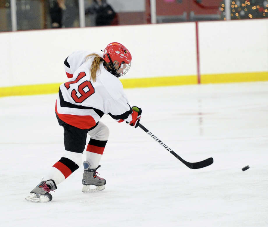Claire Eschricht (# 19) of Greenwich shoots during the girls high school hockey game between Greenwich High School and North Haven High School at Hamill Rink in Greenwich, Saturday night, Dec. 21, 2013. Photo: Bob Luckey / Greenwich Time