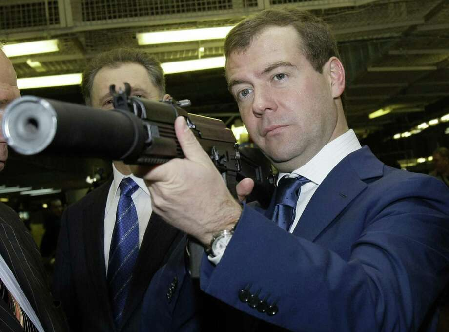 2008: Rusian President Dmitry Medvedev holds a Kalashnikov gun as he visits a plant manufacturing Kalashnikov assault rifles and other firearms in the central Russian city of Izhevsk. Photo: ALEXANDER ZEMLIANICHENKO, Getty Images / 2008 AFP