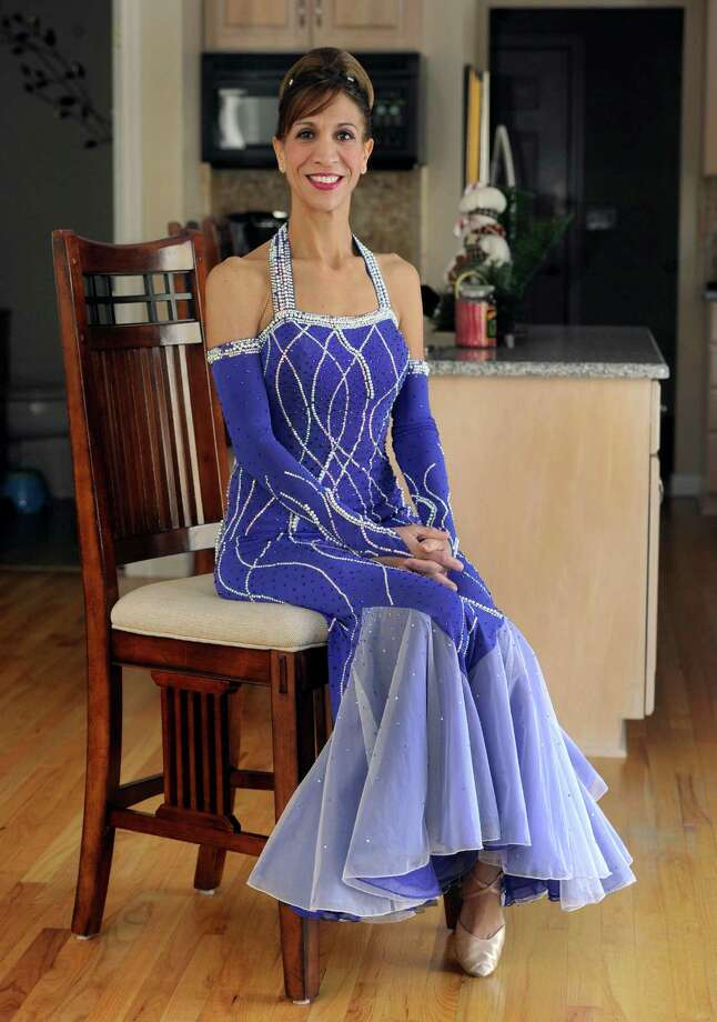 Karen Montini, 41, of Southbury, Conn., is set to launch a television reality show about ballroom dancing. She is photographed in her Southbury, Conn. home, Friday, Dec. 20, 2013. Photo: Carol Kaliff / The News-Times