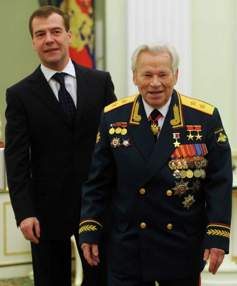 2009: Mikhail Kalashnikov meets with Russian President Dmitry Medvedev during festivities to celebrate his 90th birthday at the Kremlin in Moscow on November 10, 2009. Kalashnikov declared himself a happy man with few regrets as he celebrated his 90th birthday. Photo: NATALIA KOLESNIKOVA, Getty Images / 2011 AFP