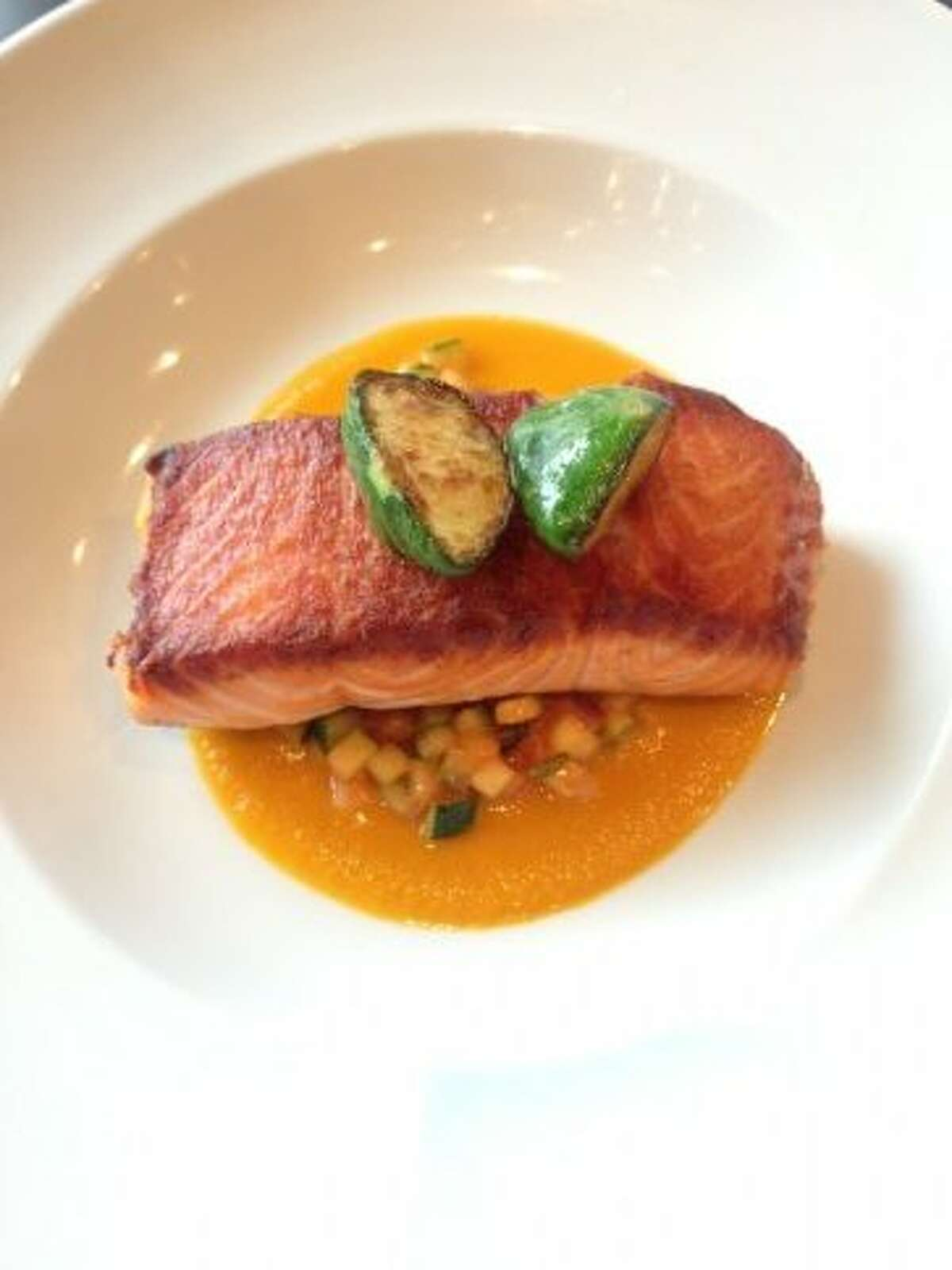 Roasted salmon with squash succotash and heirloom tomato reduction.