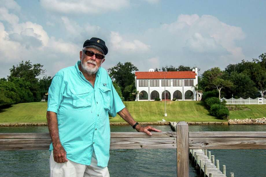 Dick Wright stands atop a decking built on a pier jutting out into Galveston Bay from the back of his Morgan's Point 1920's era house, in La Porte, Texas. Photo: Carl Shier, Freelance / Freelance