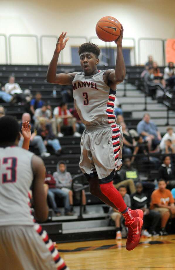 Manvel senior forward Leon Gilmore, one of the state's most exciting players, is averaging 17.5 points, 8.9 rebounds and 3.5 assists. Photo: Jerry Baker, Freelance