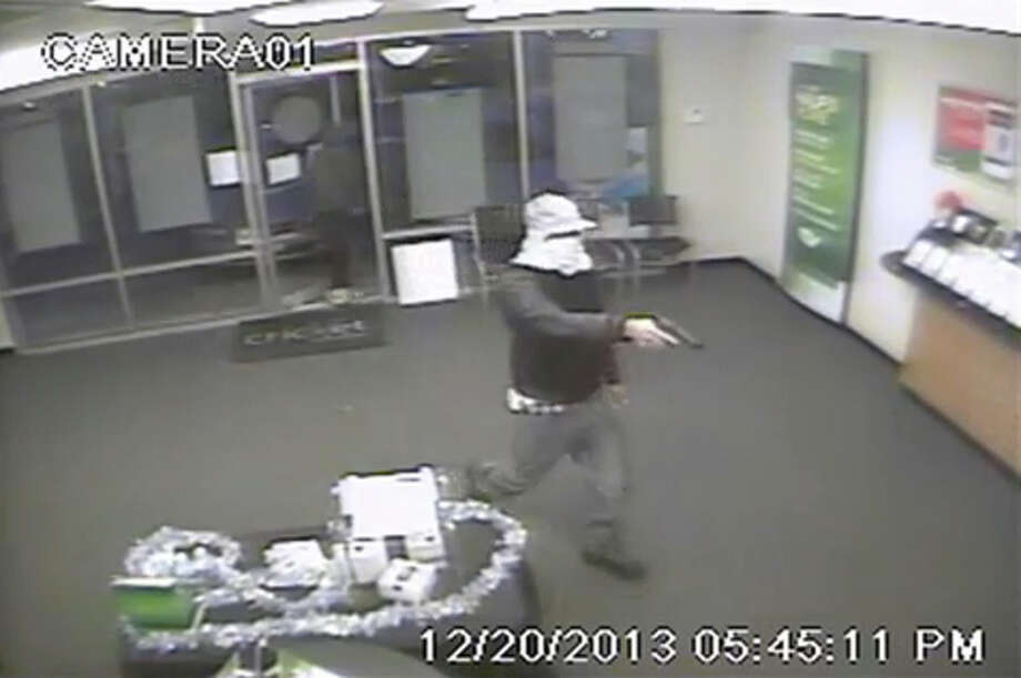 Authorities are searching for information leading to the arrest and conviction of two suspects involved in armed robberies of a salon and cell phone store on Friday, Dec. 20, 2013.