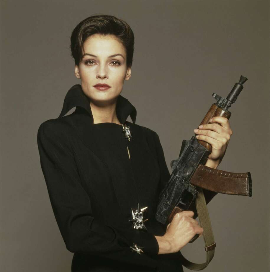 "1995: Actress Famke Janssen as Xenia Onatopp in a publicity still for the James Bond film ""GoldenEye."" Photo: Terry O'Neill, Getty Images / 2012 Terry O'Neill"