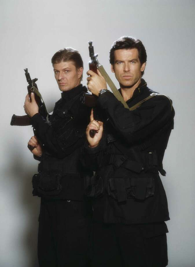 "1995: Actors Pierce Brosnan and Sean Bean hold Kalashnikov rifles in the film ""Goldeneye."" Photo: Keith Hamshere, Getty Images / 2011 Keith Hamshere"