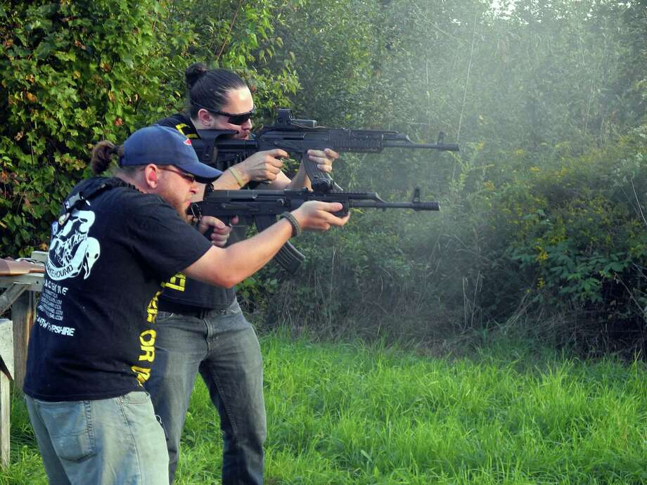 2012: Gunsmith Owen Martin, right, and friend Mat Livingston fire weapons in Webster, New Hampshire. Photo: AFP, Getty Images / 2012 AFP