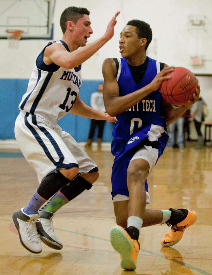 Immaculate High School's John Cartagena guards Henry Abbott Tech's Brandon Henry during the News-Times Greater Danbury Tip-Off Classic against at the Danbury War Memorial. Saturday, Dec. 21, 2013 Photo: Scott Mullin / The News-Times Freelance