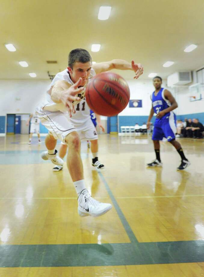 Photos from Abbott Tech's 72-67 win over Bethel in the first round of the News-Times Greater Danbury Tipoff Classic at the War Memorial Building in Danbury, Conn. on Thursday, Dec. 19, 2013. Photo: Tyler Sizemore / The News-Times