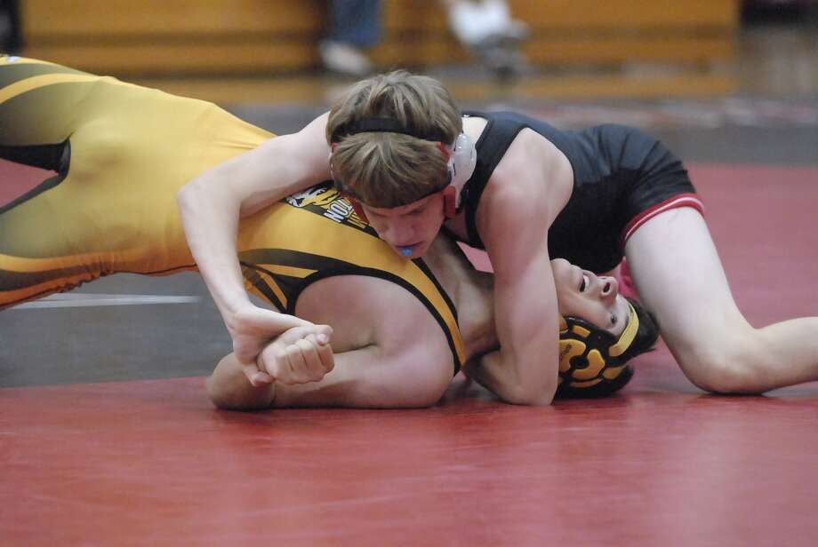 St. John's junior Jerald Barbe, top, has posted a 8-3 mark at 145 pounds. Photo: Tony Bullard / Credit: for the Chronicle