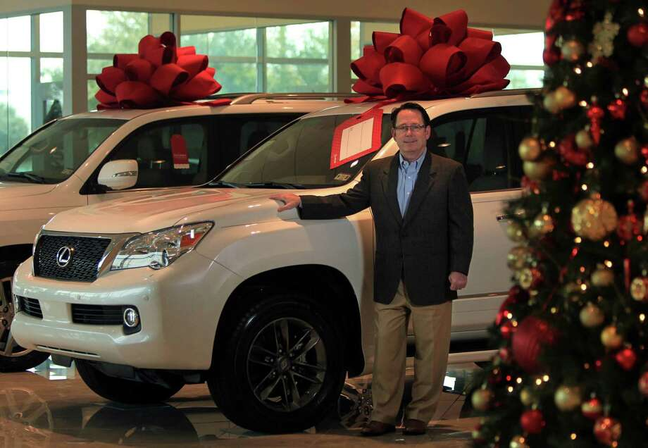 "Joey Dupuis, general manager of Sterling McCall Lexus, says: ""I've got 29 salespeople, and every one of them has one or two stories about Christmas gifts this year."" Photo: Mayra Beltran, Staff / © 2013 Houston Chronicle"