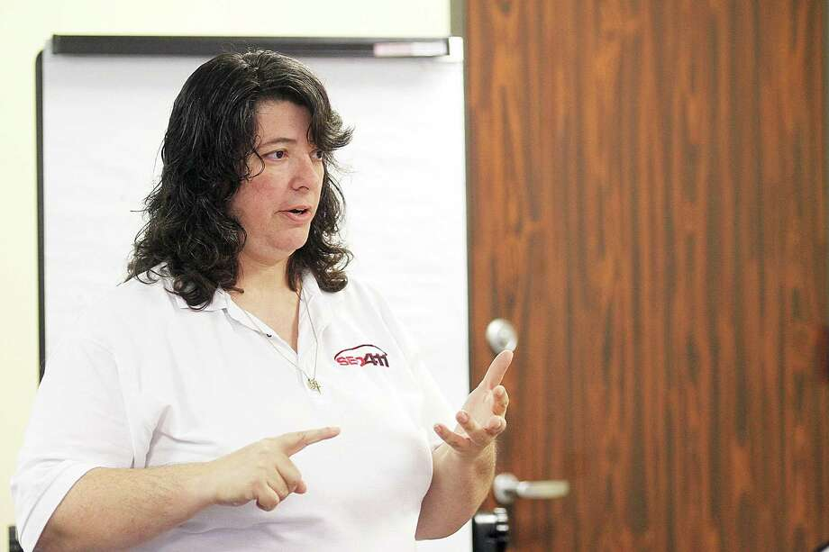 Beth Guide teaching a seminar to small business owners at the University of Houston Small Business Development Center in Midtown. Photo: Pin Lim, Freelance / Copyright Pin Lim.