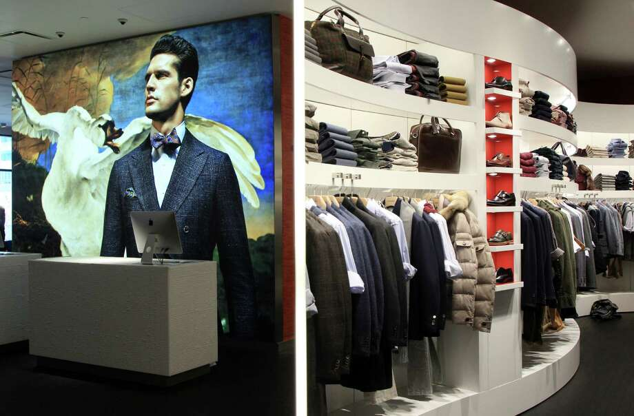 The new Suitsupply store in Houston stocks a range of men's clothing; its walls feature large photos from the brand's ad campaign shot at Amsterdam's famed Rijksmuseum. Photo: Mayra Beltran, Staff / © 2013 Houston Chronicle