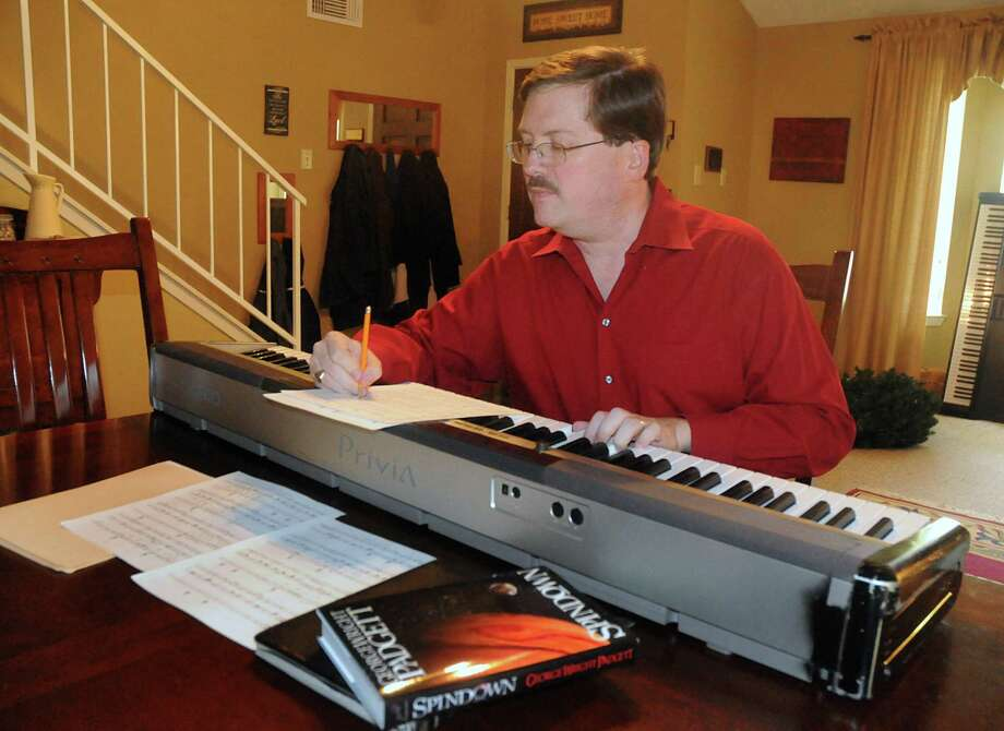 "Author George Wright Padgett works on a musical at his home in Humble, Padgett has just had his first novel, ""Spindown"" published. It is set 200 years in the future and is in the ""hard science fiction"" genre. Photo: David Hopper, Freelance / freelance"