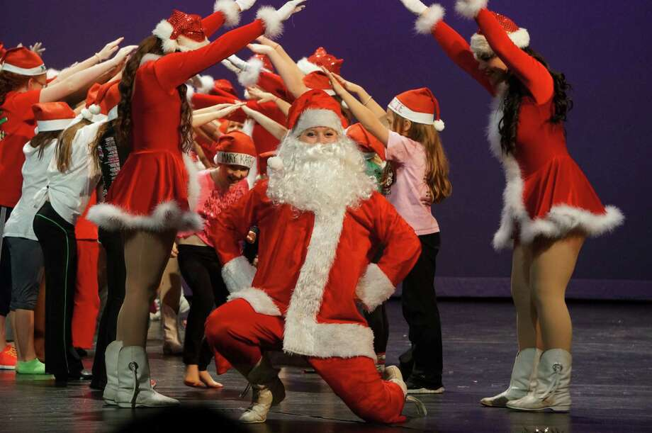 Mallory Roberson played Santa for the Kingwood Park High School Silver Stars Dance Team's holiday clinic. Photo: Courtesy Of The Humble Independent School District