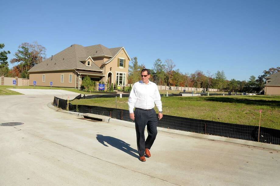 Shenandoah City Administrator Greg Smith walks through the Reserve at Grogan's Mill. Most of the lots have been sold in the new subdivision, as well as several others in the area. Photo: David Hopper, Freelance / freelance