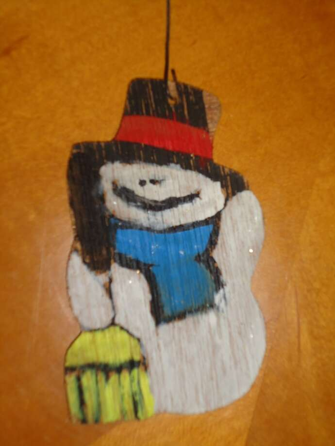 "Greg Simpson, Kingwood: This is ""Frosty"", which I made in 1976 in a fourth-grade class craft project at Thompson Elementary in Aldine ISD.  It is special not so much because I made it, but because of how much I loved my teacher that year, Ms. Jones.  She sent a Christmas card to my family every year until I was well into college.  I am certain that I am not the only student for whom she did that.  Both of sides of Frosty are painted, but my wife and I have always preferred this one because he looks like he has had a bit too much egg nog.  He always gets a prominent placement on the tree."