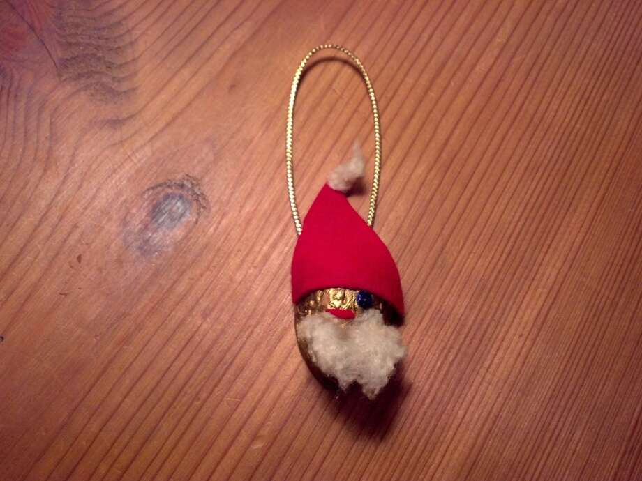Sandra Gardner, The Woodlands: My daughter made this when she was a Brownie Girl Scout. She is 53 now and it is on my tree where it has been every Christmas since she was 7. We were a military family and this ornament has been all over the world.
