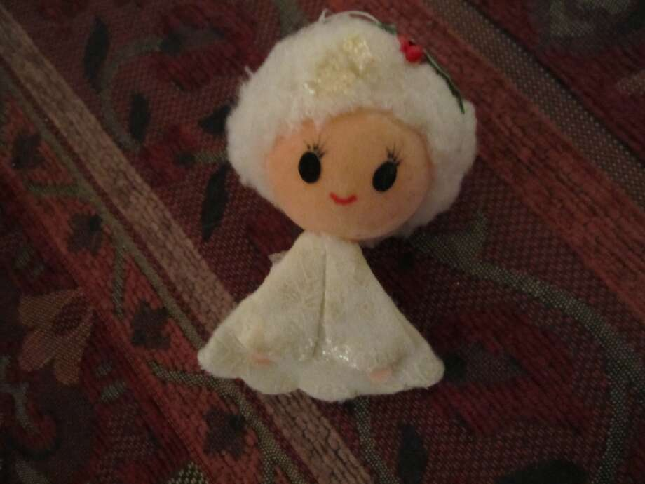 Gladys Marlin, Houston: This is my favorite ornament.  Only cost about $.50 years and years ago.  She has lost her wings, but I always loved her sweet face.
