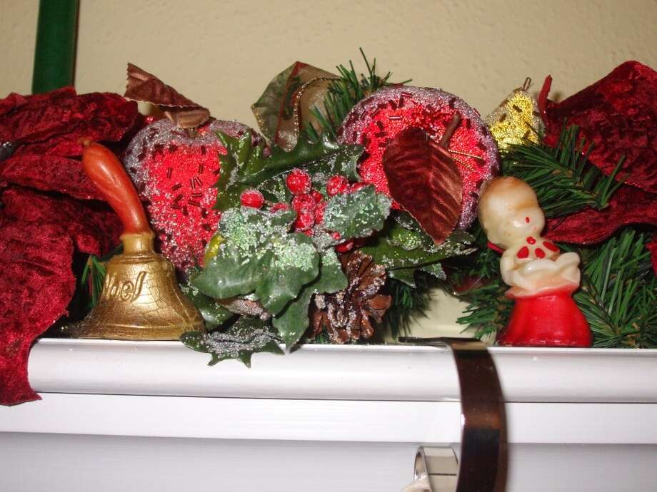 Janet Linn, Houston: Every Christmas Eve my grandmother would host dinner and gift exchange for our whole family. I grew up in central Michigan during the late 50s and there was no such thing as outdoor entertaining during December and Grandma's house was very small but it could accommodate all the aunts, uncles and my twelve cousins.  There were kids everywhere; in the hallway, in the bedrooms, probably under the dining table and definitely wall to wall on the living room floor- total chaos the whole evening.  Of course, the highlights were the meal and gifts but she always had a 'souvenir' to take home.  They were usually small candles from Woolworths, or Kresges, and she had one for everyone which she laid out on the bay window in the dining room.  Each year it was something different, an angel or a bell or choir boy, etc.  My mother managed to save some of those and I still have probably a dozen or so, however between the age of them and moving across the country to Texas they didn't fair well but the memories are still evoked every year when I unpack them and display them proudly on my mantle nestled in the garland.  Good times.