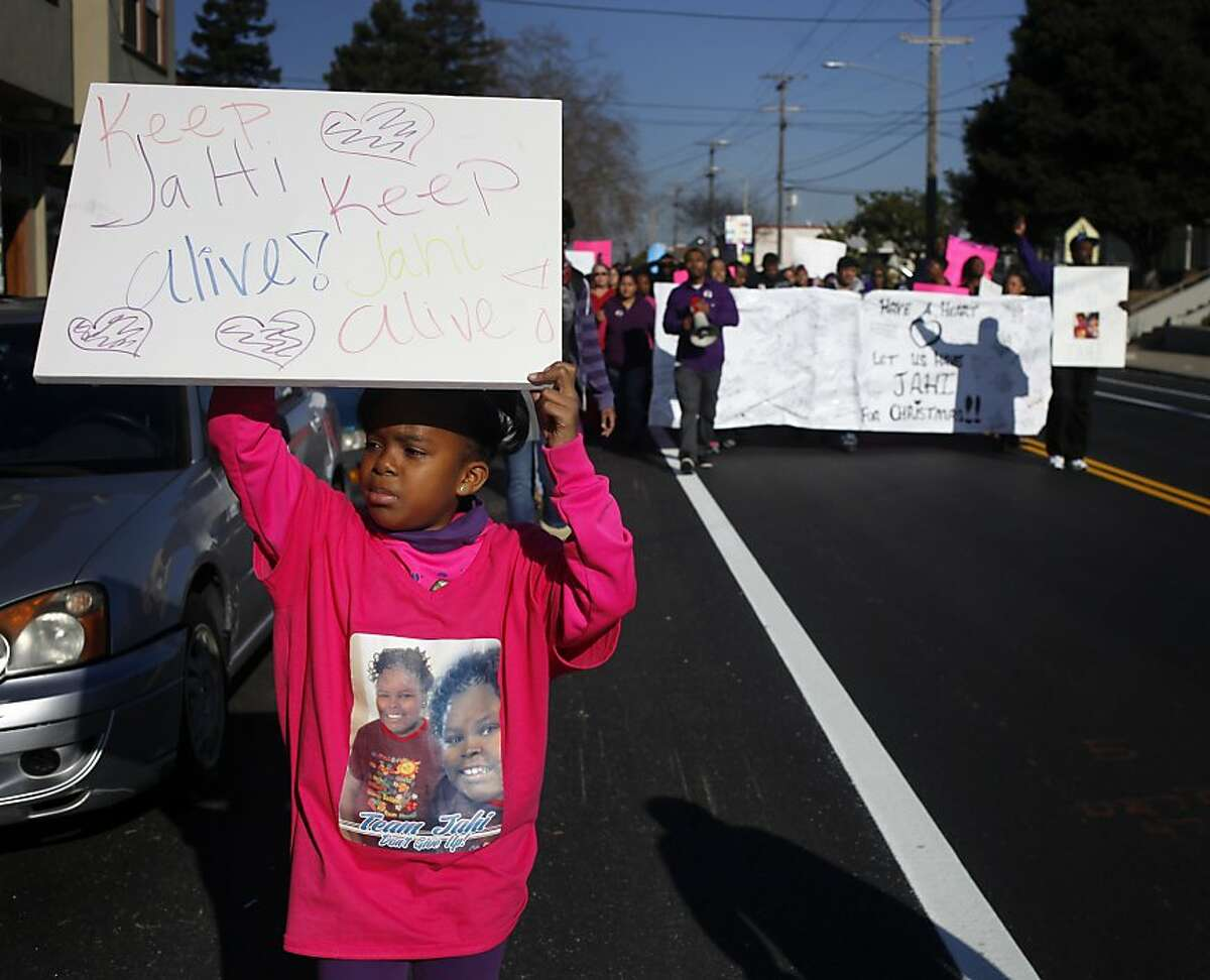 """Jahi McMath's little sister Makhai, McMath, 8, marches with other family members and supporters around the vicinity of the Children's Hospital, chanting, """"Keep Jahi alive"""", Monday December 23, 2013, in Oakland, Calif."""
