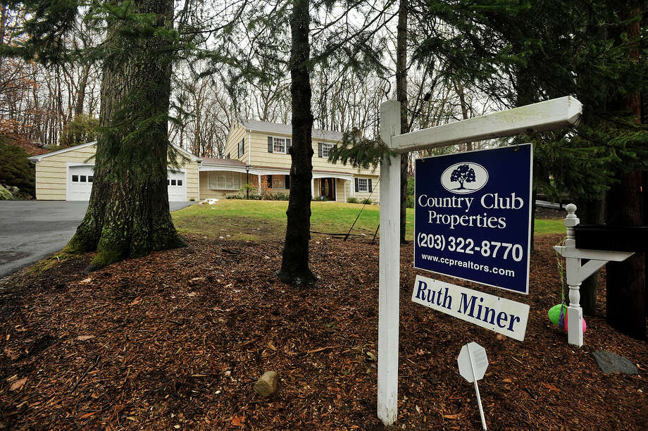 A house at 90 Wellington Drive in north Stamford, Conn., is pictured with its for sale sign in the front yard on Monday, Dec. 23, 2013. Photo: Jason Rearick / Stamford Advocate