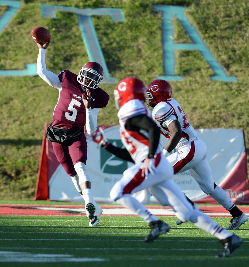 Silsbee's Patrick Reed, No. 5, throws to an open receiver during Friday's game against Carthage. Silsbee High School played against Carthage at Provost-Umphrey Stadium on Friday afternoon.  Photo taken Jake Daniels/@JakeD_in_SETX Photo: Jake Daniels / ©2013 The Beaumont Enterprise/Jake Daniels
