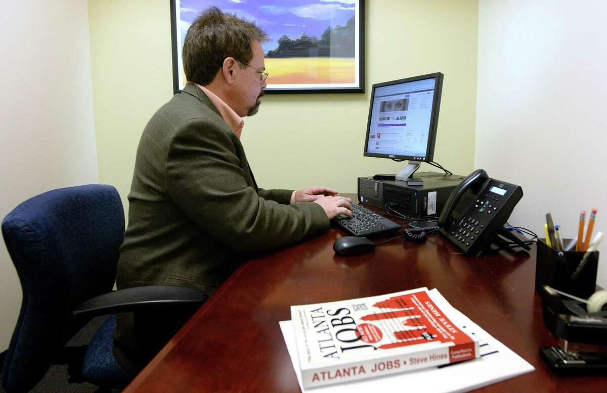 Dale Sexton, who is depending on unemployment benefits, uses a computer to search for jobs at an office where he has been getting help with his job search, Dec. 11, 2013, in Atlanta. (Hyosub Shin/Atlanta Journal-Constitution/MCT) ORG XMIT: 1146724