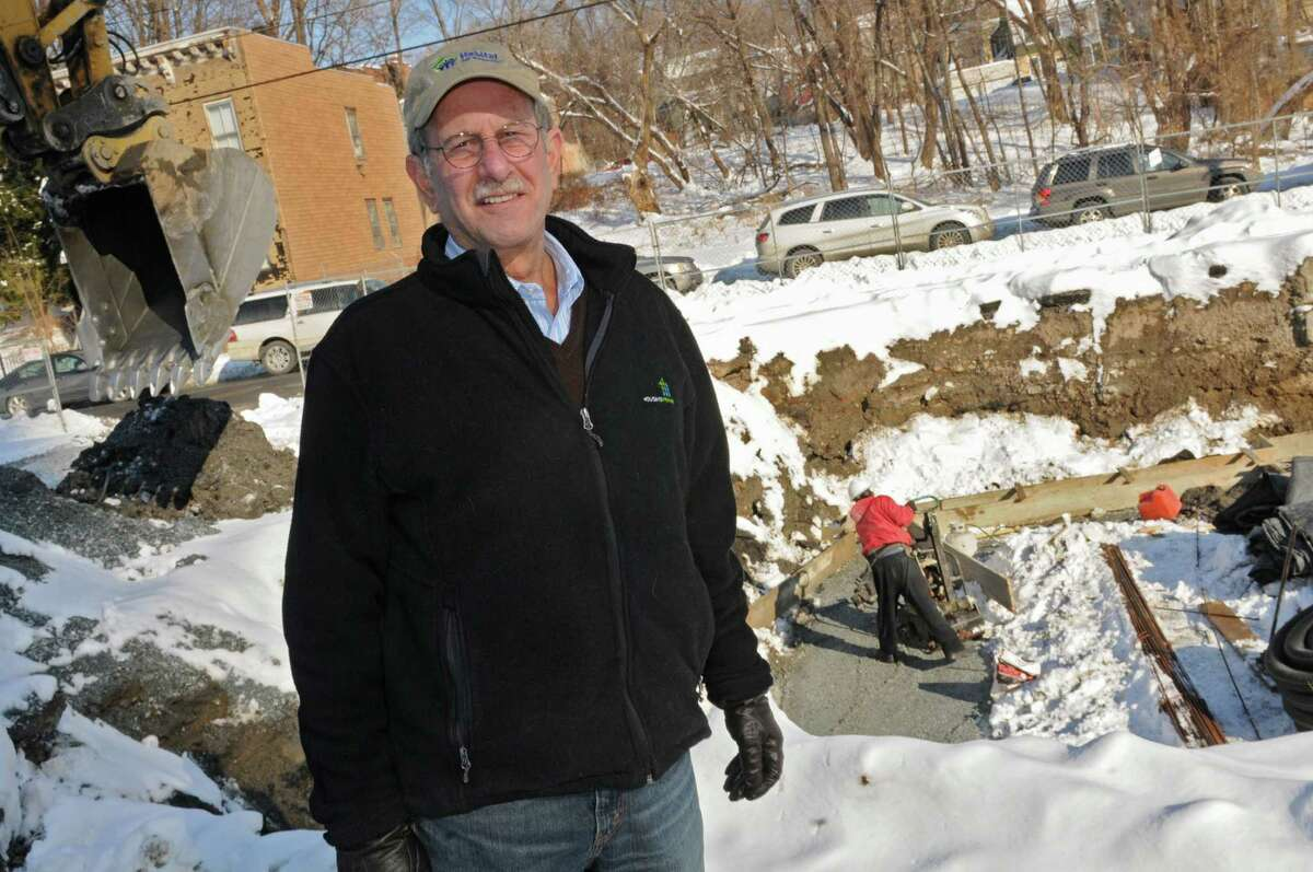 Mike Jacobson, executive director of Habitat for Humanity, stands in front of the work site on the corner of Sheridan Ave. and Dove St. on Thursday, Dec. 19, 2013 in Albany, N.Y. The crew are working on the Sheridan Hollow Redevelopment Project. (Lori Van Buren / Times Union)