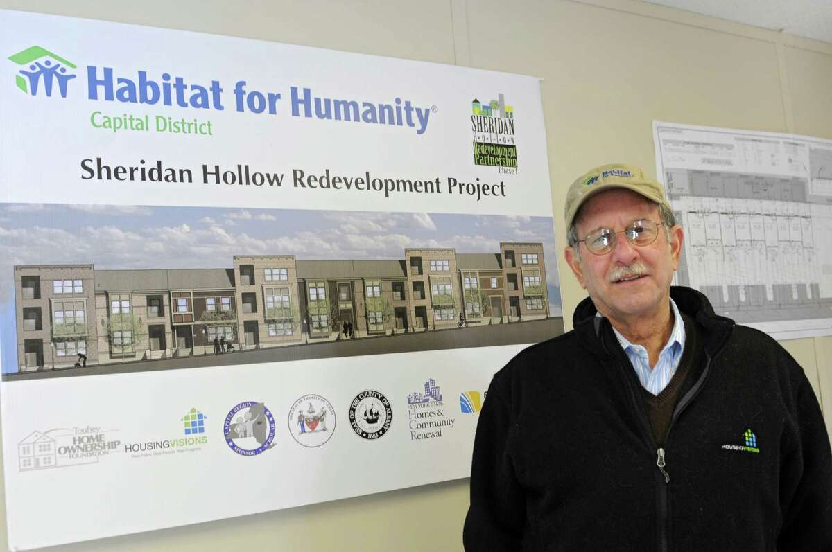 Mike Jacobson, executive director of Habitat for Humanity, stands in front of a poster for the Sheridan Hollow Redevelopment Project in the volunteer trailer at the work site on the corner of Sheridan Ave. and Dove St. on Thursday, Dec. 19, 2013 in Albany, N.Y. (Lori Van Buren / Times Union)