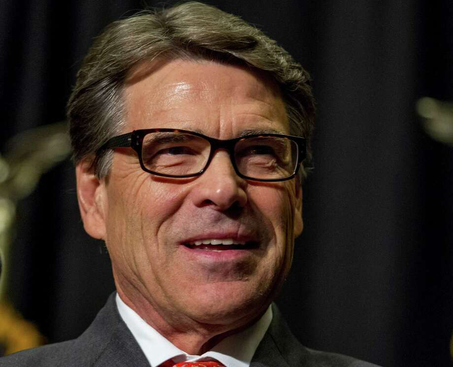 It's no secret that Rick Perry, 63, has his sights set for the White House. In early August, about a month after announcing he would not run again for governor, Perry updated his look. There's his thick dark hair, the color of which lately has been going more salt than pepper. And then there's his new classically current dark-framed eyeglasses. OK, Perry suddenly graying and wearing specs to possibly land him into the Oval Office may be a bit of, well, over speculation. But according to style experts, the look on the potential commander in chief is smart (operative word, here), as in brainy and stylish. Photo: Justin Hayworth, Associated Press / FR170760 AP