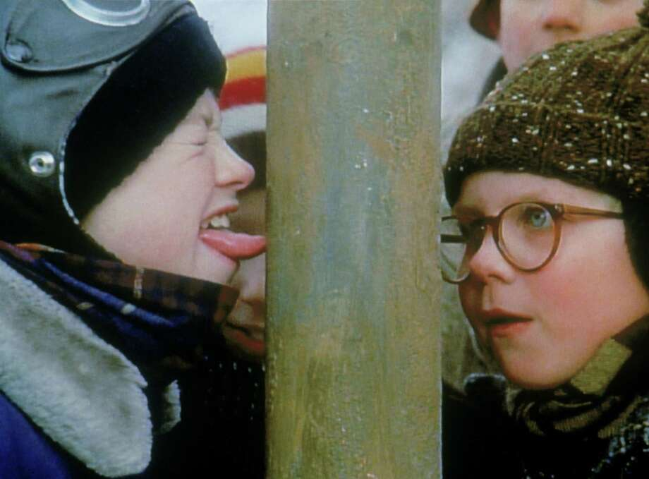 In this now famous scene, Flick (Scott Schwartz) gets his tongue stuck to a flagpole while Ralphie (Peter Billingsley) watched. To make the scene work, a hidden suction tube was used to safely create the illusion. Photo: (C) TURNER BROADCASTING, INC.