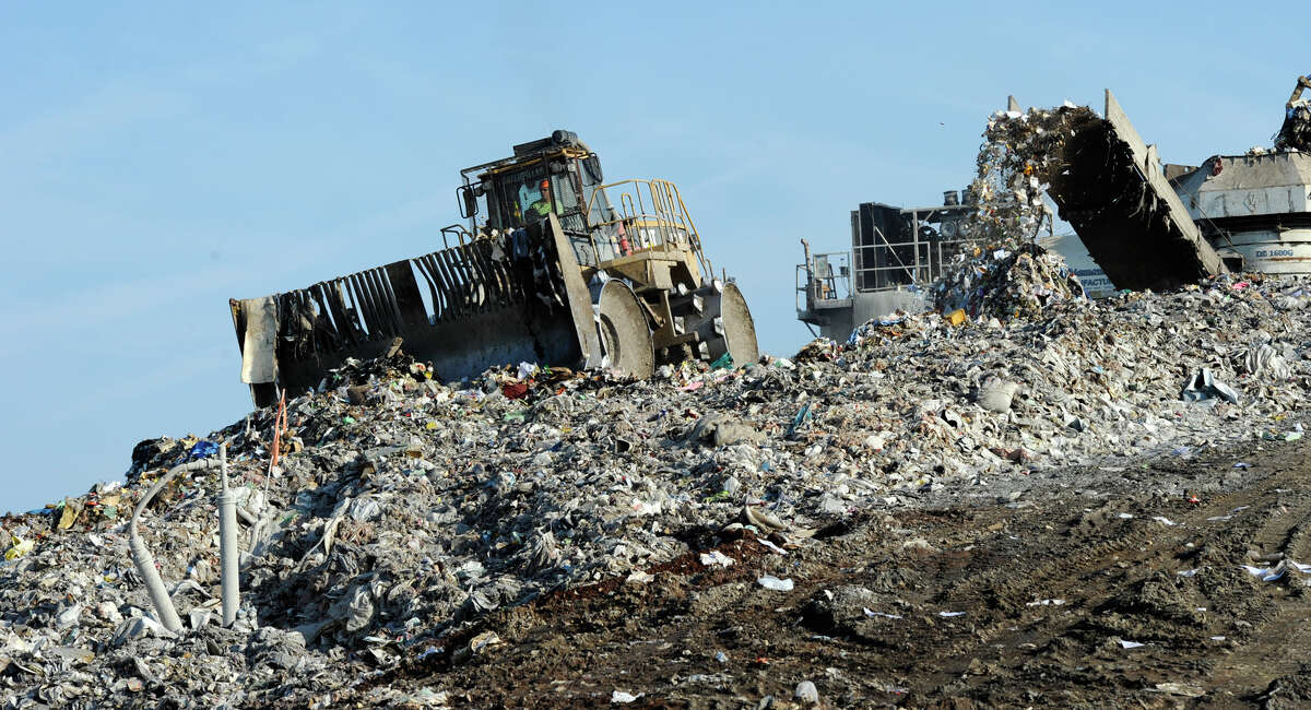 Heavy machines moves tons of waste -- including plenty of plastic bags -- at the Rapp Road Landfill in Albany. (Skip Dickstein/Times Union)