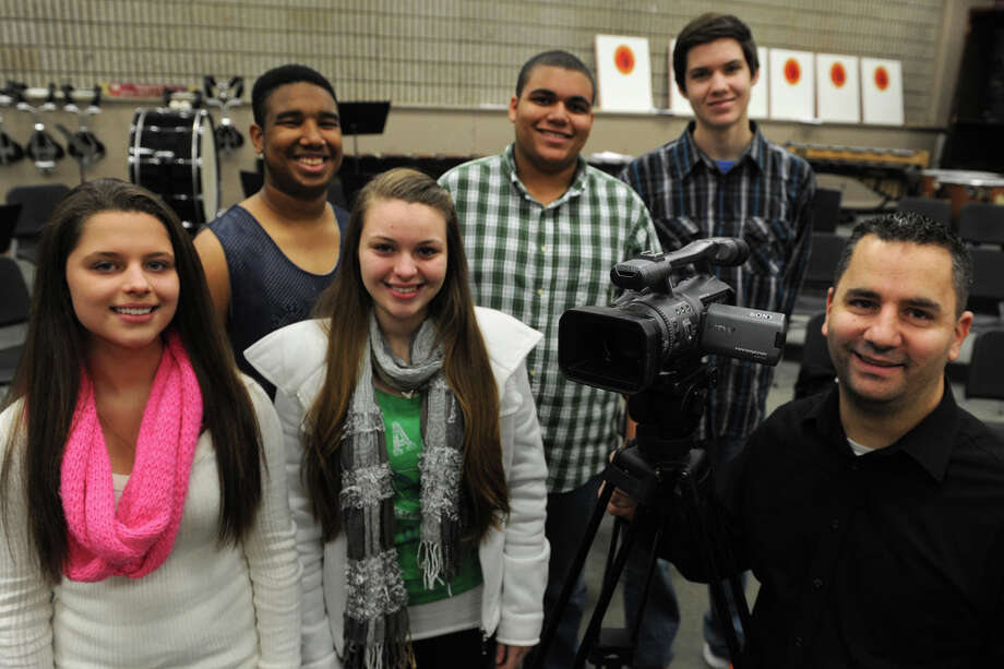 Film director Lou Spetrino, right, stands with Stratford High School students, from left, Samantha Rivera, Kaitlyn Schuessler, Aamir Kadeem, Chris Smith and Autin Bult. He is helping the students produce an independent film. Photo: Ned Gerard / Connecticut Post