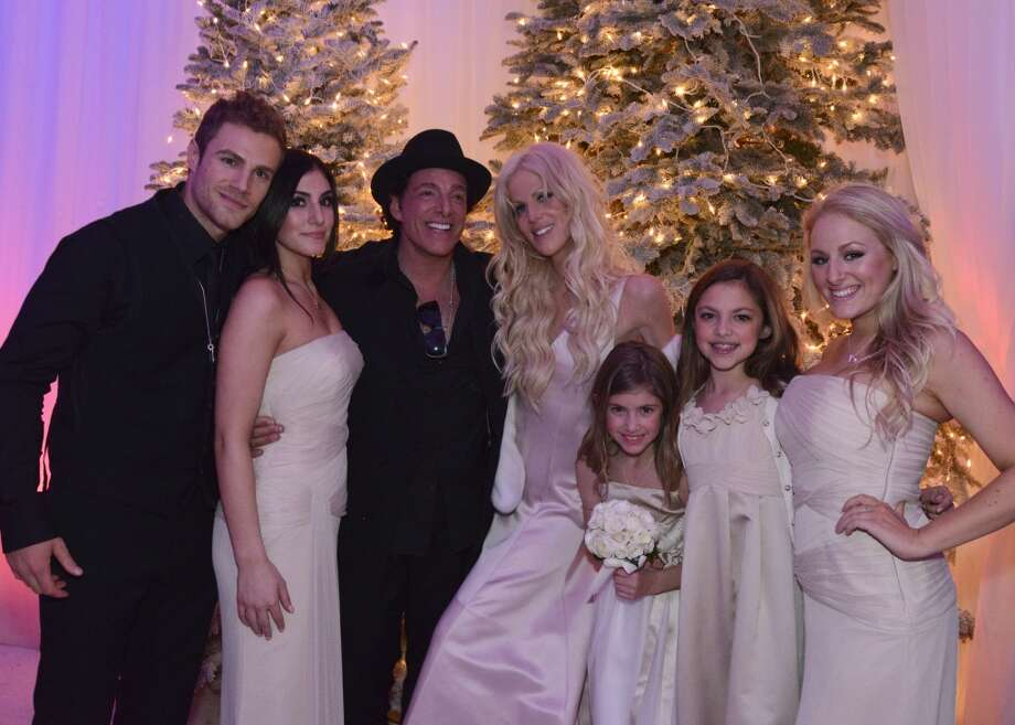 "SFUnzipped/SFChronicle photo exclusive: Journey guitarist Neal Schon and bride Michaele Schon, with Neal's five children at the ""Winter Wonderland and Wedding"" in San Francisco. Michaele wore several gowns during the event, including this one by Christian Dior. Bridesmaids including the lovely ladies here wore Vera Wang gowns. From left to right: Miles, Sarah, Neal, Michaele, Sophie, Aja, and Lizzy Schon. Photo: Neshan Naltchayan For Getty"