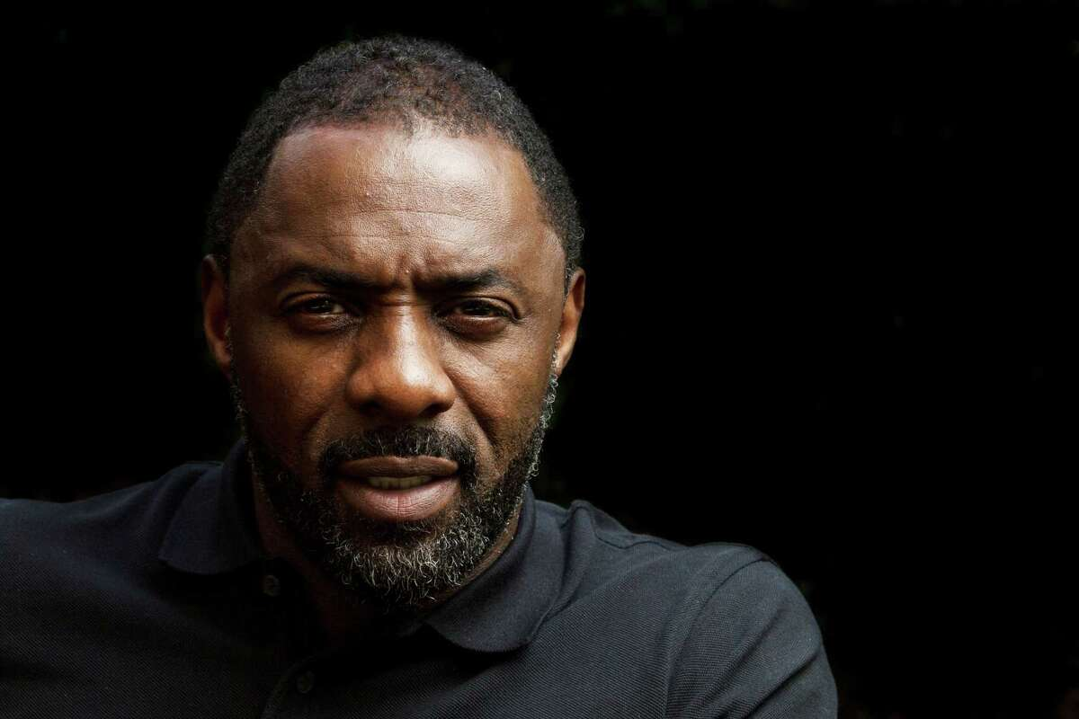 In this Sunday, Nov. 10, 2013 photo, actor Idris Elba poses for a portrait at the Four Seasons in Beverly Hills, Calif. Elba knew his latest movie wouldn?'t be believable, unless his fellow actors could deliver a performance as raw as his own. When portraying South African revolutionary Nelson Mandela in the biopic ?