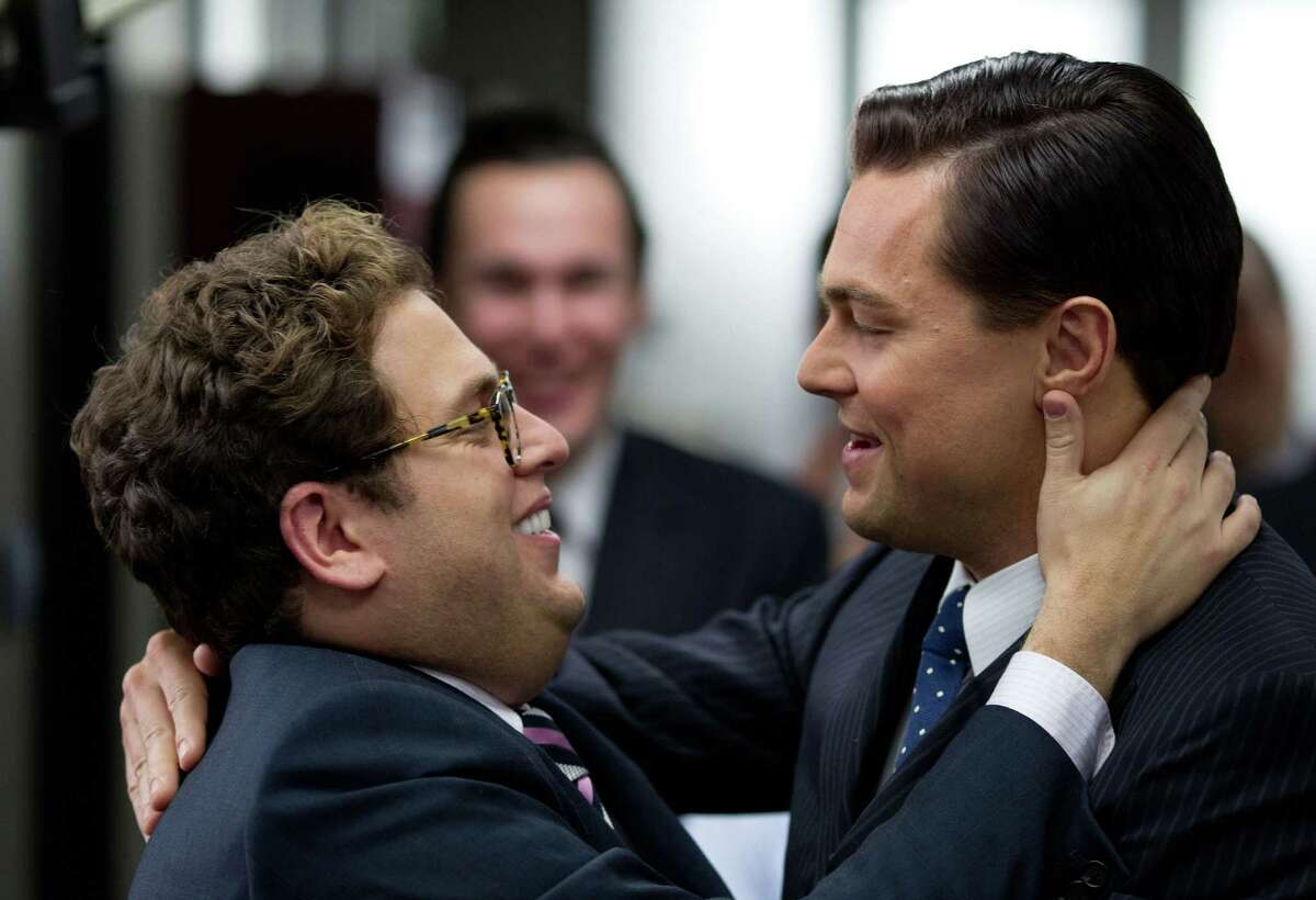 This film image released by Paramount Pictures shows Jonah Hill, left, and Leonardo DiCaprio in a scene from