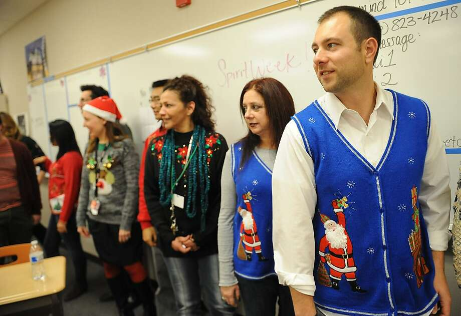 Josh Frishman (right), Marisa Belleci and other Pittsburg High teachers take part Friday in an ugly sweater competition. Photo: Susana Bates, Special To The Chronicle